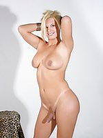 Beautiful blonde shemale strips naked
