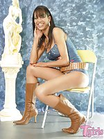 Tgirl Marcela masturbates on a chair