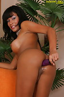 Titty tgirl with a purple dildo