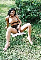 Dark Haired Exotic Tranny Riding In Garden