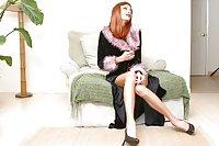 Busty Redhead Posing In Corset On Sofa