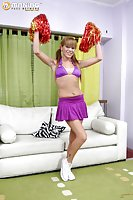 Cheerleader With Pigtails Shows Her Cock On Sofa