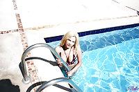 Busty Blond Tranny In Bikini Bends Over In Pool