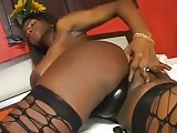 Chocolate TS in stockings ramming lover on bed