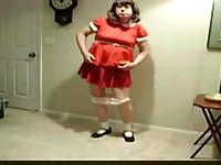 Lewd Transsexual In Red Dress Got A Toy