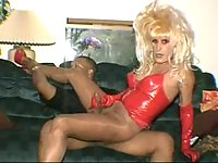 Hot Tgirl in latex lingerie stuffing