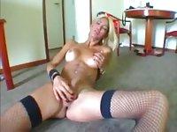 Pretty tranny in lingerie masturbating