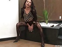 Flat chested shemale Leticia in fishnet solo