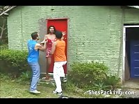 Cute shemale gets banged by two guys outdoors