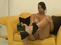 Heeled ebony tranny masturbates and cums