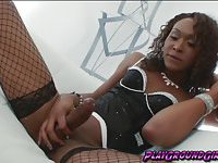 Sweet and sexy tranny playing with a huge cock