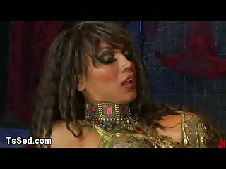 Tied up guy sitting on huge cock of busty tranny