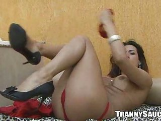 Foxy tranny babe gets naked and jerks her cock