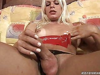Cute blonde tart plays with red dildo