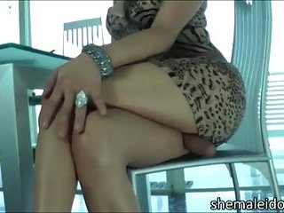Horny brunette strips & fucks herself with dildo