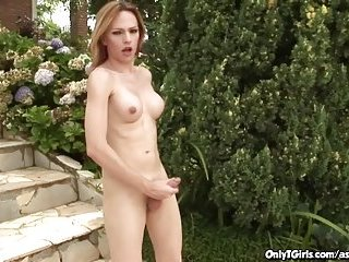 Hot Blonde Shemale Masturbating In The Garden