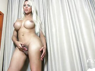 Azeneth strokes her huge cock and cums on her belly